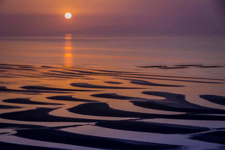 Sonnenuntergang an der Okoshiki-Küste
