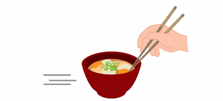 Mit Stäbchen Gerichte verschieben